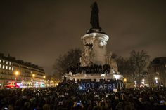 A sign reads Not Afraid as thousands gather for a candle light vigil on Place de la Republique in central Paris hours after the attack by two gunmen on the Charly Hebdo headquarters in Paris, France, on Jan. 7, 2015. (Photo by Ian Langson/EPA)
