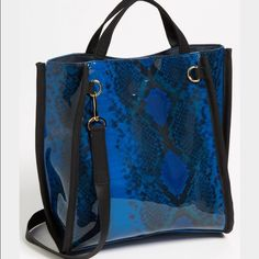 French connection tote! Blue snakeskin tote ! It is plastic so , you don't have to worry about spilling anything on it ! Super cute and fun ! Great for the spring and summer! Will post more pictures of the actual bag ! French Connection Bags Totes
