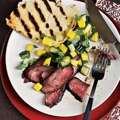 Grilled flank steak receives an extra punch of flavor when topped with fresh mango salsa. Serve with Garlic Flatbread.View Recipe: Grilled Steak with Fresh Mango Salsa Steak Menu, Flank Steak Recipes, How To Grill Steak, Beef Flank, Bbq Grill, Grilling Recipes, Beef Recipes, Cooking Recipes, Gourmet