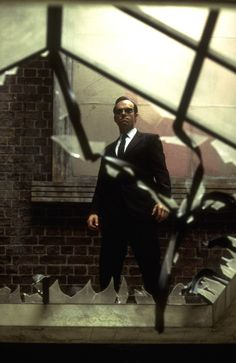 Agent Smith from The Matrix Trilogy (1999-2003). Played by Hugo Weaving.