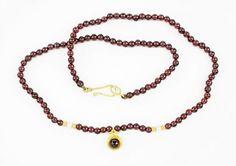 A Garnet and 18 Karat Yellow Gold Necklace. Lot 165-7109