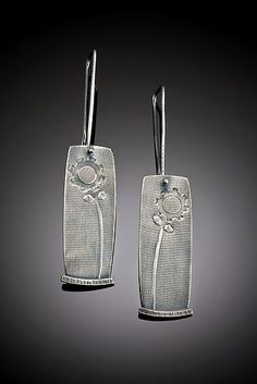 stem earrings by Tavia Brown. (multiple passes thru rolling mill using screen, cogs and gears.