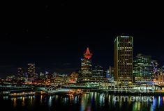 View of the modern night city with luminous skyscrapers and the ocean Night City, Skyscrapers, Night Photography, Cityscapes, Wood Print, Seattle Skyline, Empire State Building, Beach Towel, Night Light
