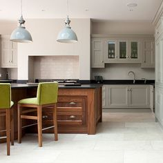 Kitchens: Traditional Kitchen with Hardwood Cabinet also Green And Wood Stools plus Industrial Pendant Light and Black Worktop
