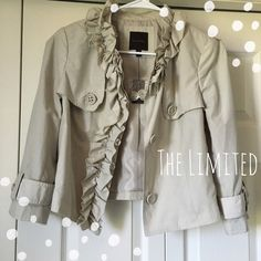 Cropped Ruffle Rain Jacket Adorable cream-colored cropped jacket by The Limited. Ruffle detailing. Front buttons. Cropped style. Three-quarter length sleeves. Fits true to size. Never worn. The Limited Jackets & Coats