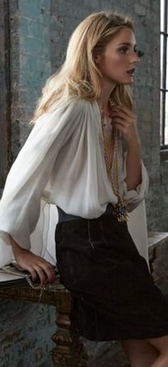 Shirt – Lanvin  Necklace – Oscar de la Renta  Skirt – Dolce & Gabbna  Purse -- Chloe