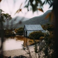 "Peek-a-boo! This boat shed at Cradle Mountain's Dove Lake is an incredibly photogenic spot and humbles the entire landscape with a ""real… Boat Shed, Tasmania, Peek A Boos, North West, Real Life, Australia, Mountains, Landscape, House Styles"