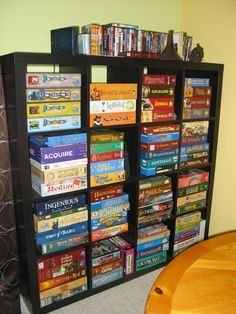 When I'm old, I'm going to have soooo many game… Ikea Board Game Storage. When I'm old, I'm going to have soooo many games. A party of four shall never be bored at my house. Board Game Storage, Board Games, Board Game Organization, Board Game Shelf, Game Room Basement, Teen Basement, Toy Rooms, Game Rooms, Organization Ideas