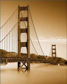 Golden Gate Bridge in clouds.
