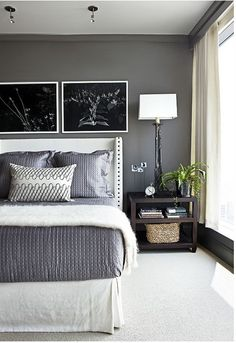 Benjamin Moore Kendall Charcoal HC-166  Great colors, funky headboard, not sure if I could pull it off with smaller windows since this room lets in so much light.