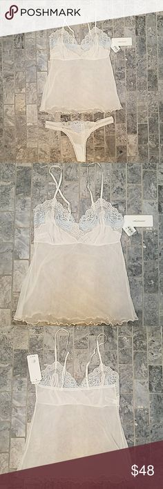 OnGossamer Camisol and Thong Set in Ivory OnGossamer Camisol and Thong Set in Ivory w/blue and white flowers. Beautiful sheer on gossamer Cami and thong set. Please note phones are a small medium and Cammie is a medium large. Songs fit as a regular small medium wood and the median large Cami probably fits like a medium Cami. OnGossamer  Intimates & Sleepwear Panties