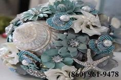 Find the best selection of wedding bouquet jewelry here at Couture Jewelry Bouquets. Unique and special bridal bouquets for wedding which will make your wedding day last a lifetime. Seashell Bouquet, Nautical Wedding Inspiration, Simple Beach Wedding, Most Beautiful Wedding Dresses, Corsage And Boutonniere, Wedding Brooch Bouquets, Strictly Weddings, Wedding Reception Decorations, Wedding Ideas