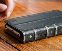 An iPhone case that looks like a leather-bound book.