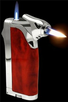 Superb Multi Flame Cigar Lighter With Cigar Punch #111 by BeWild. $20.95. This high quality, super premium cigar lighter is the only choice for the advanced Cigar Smoker. The Gentleman's Triple Torch Cigar Lighter features electronic ignition, Triple Torch Adjustable Flame & a stainless steel retractable hole punch that is perfect for all cigars. This all in one unit is all a cigar smoker needs to get going. Style, Function and reliability make this our best cigar li...