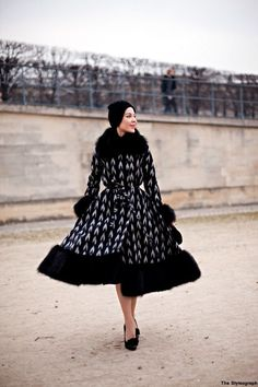 """Another pinner says: """"Ulyana at Paris Fashion Week. I admire that she prefers voluminous skirts over showing too much skin, which so many others do""""  I MUST have this in white and sparkles. Ok, and maybe this black one to change up the look too."""