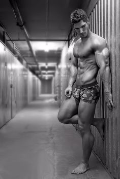 In this Daily Package, a well-muscled and all-to-perfect-looking model poses up against a wall in a pair of camouflaged Diesel trunks. He's just so shiny!