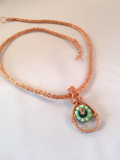 Copper viking knit with handcrafted glass bead pendant. Handcrafted by Blueberry Bay Beads located on the coast of Maine.  www.blueberrybaybeads.com