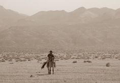 Nevada cowboy riding near Lovelock