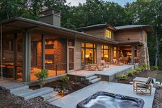 The Walnut Cove Residence combines the clean lines and simplicity of modern design with the warmth and functionality of a cozy home. Asheville, Design Studio, Casa Top, Home Addition Plans, New Home Designs, House In The Woods, Cozy House, Porches, Arquitetura