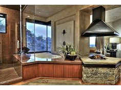 Unparalleled views in Paradise Valley! This majestic estate sits atop Mummy Mtn. with unbelievable views of Camelback Mtn and city lights. This masterpiece has 4 bedrooms each with its own private bathroom and patio. Master bedroom provides a private escape with sitting room with fireplace, large walk in closet, steam shower. #zillow