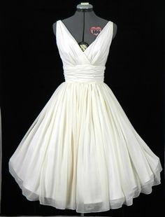 Simple and elegant 50s style dress. Ivory chiffon overlay, flattering for all sizes