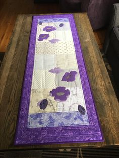 Pretty purple flower appliques adorn this lovely Table Runner.