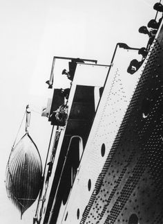 April 10, 1912: Titanic preparing for her maiden voyage. Captain Smith can be seen looking out from the bridge.