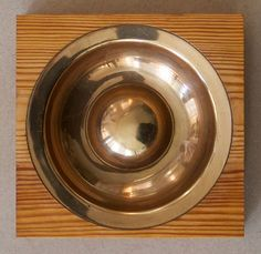 TAPIO WIRKKALA, Bowl in bronze and pinewood, model TW 488. Designed in 1958 and manufactured by Kultakeskus Oy, Finland. / The Exchange Int.