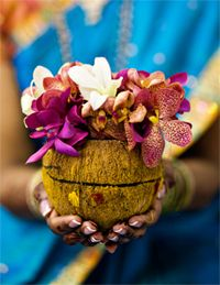 purple and white flowers. I like the coconut shell holder!