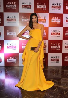 Athiya Shetty in a flowing strapless marigold Gauri and Nainika gown at the 2015 Vogue Beauty Awards.  Thx Vogue.in
