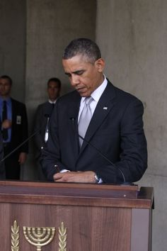 President Barack Obama signs the Visitors Book at the conclusion of his visit