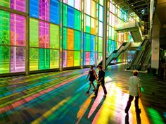 The Palais des Congrés de Montreal ~ with its multicolored facade is the site of many meetings and conventions. A generously dimensioned, wedge-shaped pedestrian mall runs the entire length of the building.  Bathed in both natural light and a luminous ceiling, this space links rue Saint-Urbain on the east with a spectacular public room, the new Hall Bleury, on the west. #Montreal #Architecture #Palais_des_Congres #Old_Montreal
