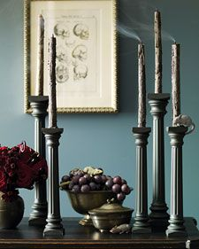 Think of Dracula's parlor and its eerie dark Gothic candlesticks. Create such a display quickly and inexpensively using columns made for tiered wedding cakes. Coat them with matte-gray spray paint, fit candles into the holes, and light. Since the columns are lightweight, it's safest to anchor them to a tabletop or mantel with candle adhesive.