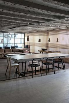 Faliro Loft by ése Studio in Athens | Industrial converted loft space with exposed raw materials
