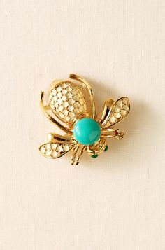 Bee Brooch: Set them abuzz with this whimsical brooch dotted with glass beads. Mix it with any of our necklaces in the La Coco Collection by pinning the brooch anywhere along the chain, use the special hooks to lengthen the style at the clasp, or wear it alone.  Simply gorgeous.