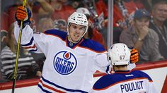 Connor McDavid scored twice and added an assist for the first multi-point game of his young career as the Edmonton Oilers beat the host Calgary Flames on Saturday. World Sports News, Connor Mcdavid, Sport Icon, Edmonton Oilers, Toronto Maple Leafs, Hockey Players, Calgary, Nhl, Guys