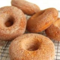 Baked Doughnuts dipped in butter followed by cinnamon sugar... um... YUM!