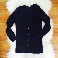 J crew black floral corsage cardigan You're looking at a preloved J. Crew cardigan in size small. Black in color, v-neck style with abalone type buttons.  Beautiful floral appliqué goes along left chest. 3/4 length sleeve. Super soft 100% cotton. offers bundles for discounts PayPal trades J. Crew Sweaters Cardigans