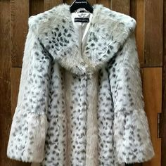 Low Price - time limit! NWT!  Incredibly elegant and beautiful!  Never worn, just sat in my sister's closet after purchase.  Black, white, cream, and grey colors.  Snap hook closures.  Perfect condition and from a smoke free home.  Make me an offer!  *I'm going to take this in for dry cleaning before I ship  because my sister loves to Febreeze everything in her closet and the coat has faint artificial scent.  Therefore, I believe the tags will have to be cut off, but I will make sure to send…