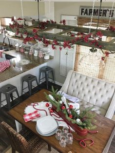 Farmhouse Kitchen Christmas Decor view of suspended ladder light