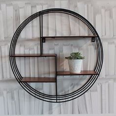 Circular black wire shelving unit with small copper shelves.Easily wall mountable and suitable for any room.                                                                                                                                                                                 More