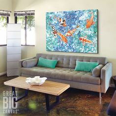 Bring a sense of serenity to your living room with gorgeous combination of blue and aqua tones. Check it out at GreatBIGCanvas.com