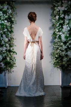 I Love Paris - Stewart Parvin. Photography by www.davidburkephotography.co.uk An effortlessly elegant gown with the top in silk crepe and the fishtail skirt and puddle train in Mantilla lace finished with To Catch a Thief embroidered floral belt. #weddingdress #elegant #fishtail #floral #belt