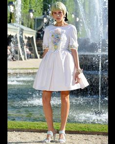 Futuristic neons and plastics meet courtisanly embellishment and high, cinched waists in the 2012/13 Chanel Cruise Collection, presented in the heady grounds of Chateau Versailles.