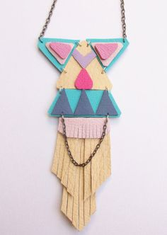 Candy Pastels with bright pink and turquoise shades of leather, hand cut in a geometric, tribal, circus inspired style necklace. A large, highly