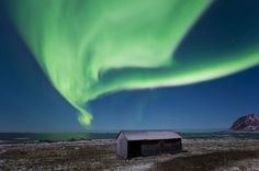 A blanket of green hangs over the coast ofBø in northern Norway in a picture taken January 6.