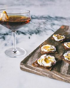Cheese + Cocktail Pairings.  Sweet & savory comes together in these goat cheese bites topped with pumpkin butter and maple syrup.  Serve with a little hanky panky cocktail for a refreshing treat. #chevreforevre