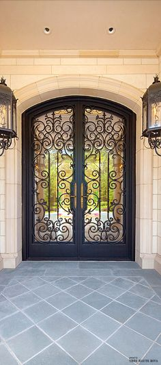 Custom Wrought Iron door and lanterns