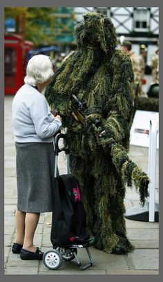 Camouflaged soldier in a ghillie suit
