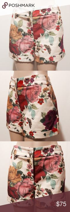 """Ted Baker Cream Floral Printed Shorts Wow! Hot house rose with butterflies, bees and ants - too cute. Fully lined, slash front pockets, sealed welt back pockets. Front fly zipper 2"""" contour waist band with belt loops with 1"""" cuff.   100% poly  97% poly 3% elastane (lining)  Hand Wash (I have always dry clean)  13"""" outseam 3 1/2"""" inseam 13"""" leg opening Ted Baker Shorts"""